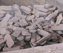 Pig iron of a type used to make ductile iron, stored in a bin